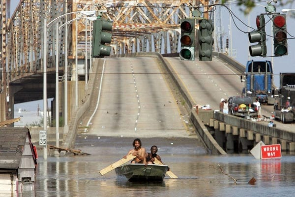 NEW ORLEANS - AUGUST 31:  Two men paddle in high water after Hurricane Katrina devastated the area August 31, 2005 in New Orleans.  (Photo by Mario Tama/Getty Images)